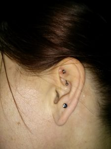 Rook and 3rd lobe Michelle M - Almost Famous Body Piercing