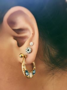 multiple ear piercings with hoop - Almost Famous Body Piercing