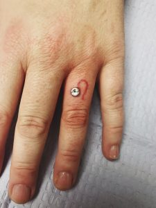 Dermal Piercing on finger - Almost Famous Body Piercing